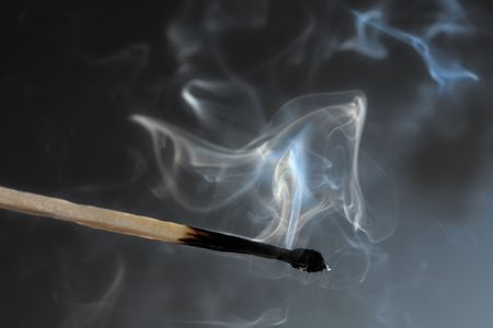 match head: Photo of smoldering match that has just been extinguished.