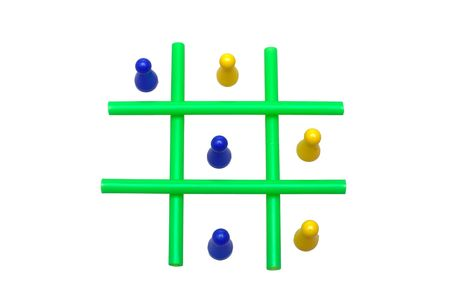 Photo of a Tic Tac Toe game in progress. The objects are isolated over white. Stock Photo - 2047492