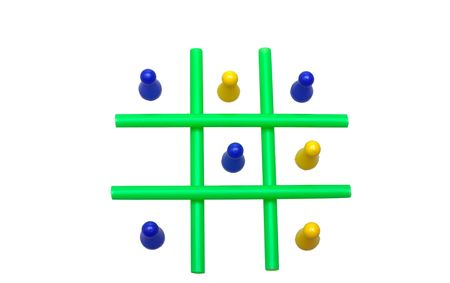 Photo of a Tic Tac Toe game in progress. The objects are isolated over white. Stock Photo - 2047490