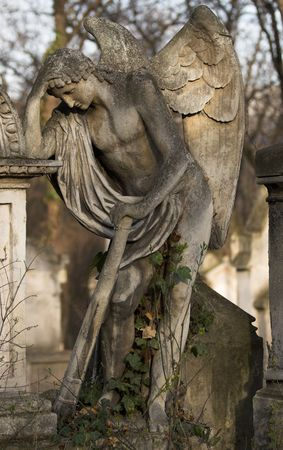 memento: Picture of a stone angel on a grave stone. Stock Photo