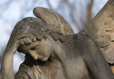 Close-up of a stone angel on a grave stone. Stock Photo