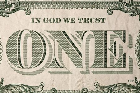 in god we trust: Extreme macro shot of a one dollar bill. Stock Photo