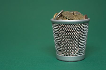 tax tips: Photo of a waste basket full of coins.