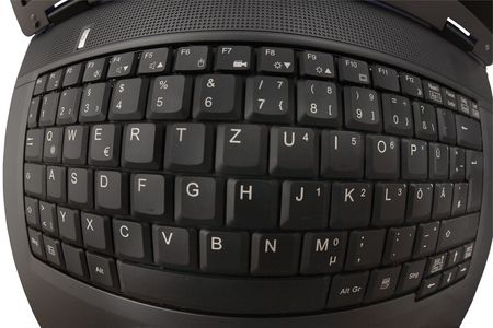 Fisheye shot of the keyboard of a laptop. The computer is isolated on white. photo
