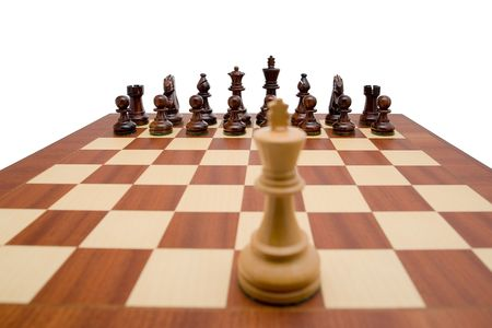 King looking down the chess board at the opposing pieces Stock Photo - 2662540