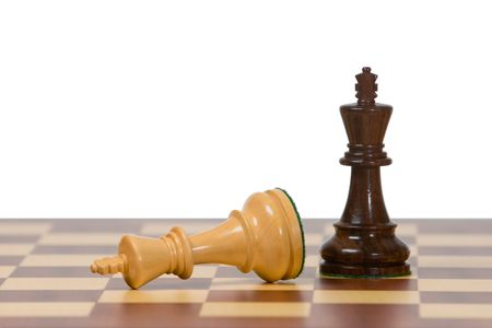 Two kings on a wooden chess board against a white background. photo