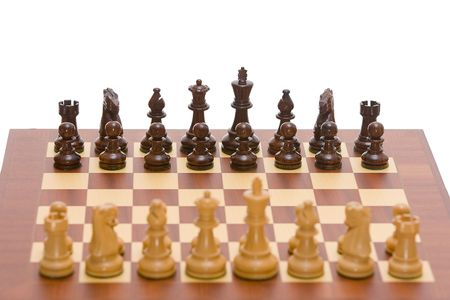 Chess board with a full set of chess pieces - the focus lies on the black pieces. A clipping path is included for easy extraction. Stock Photo - 2673241
