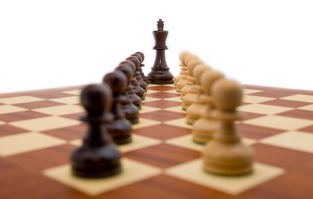 Chess pieces - a king guarded by two rows of pawns. Stock Photo - 2673234
