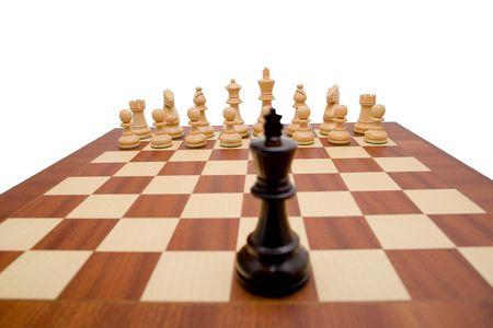 King looking down the chess board at the opposing pieces.