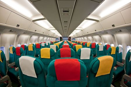 Photo of the passenger cabin of a commercial airliner.