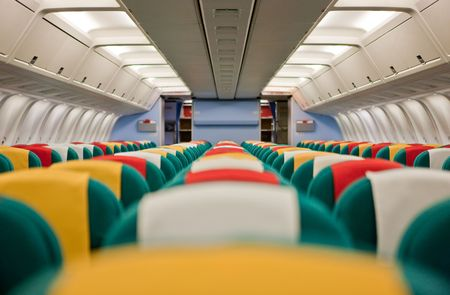 Photo of the passenger cabin of a commercial airliner. photo
