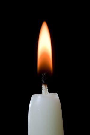 ignited: Burning candle that has just been ignited.