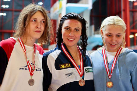 Vienna, Austria - November 29 2008; 400 swimmers from 12 nations take part in the 35th Stroeck Austrian Qualifying. Shown are the winners of the 200m breaststroke event Helene Pikhartova, Mirna Jukic, and Sandra Swierczewska (left to right). Stock Photo - 8194565