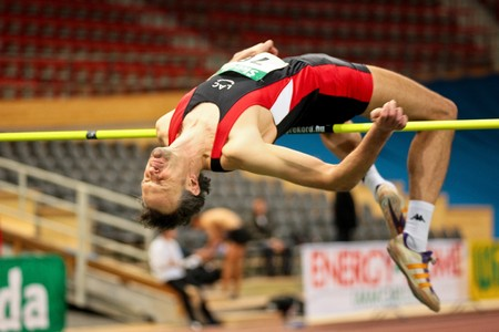 VIENNA, AUSTRIA - FEBRUARY 21: Indoor track and field championship: Guenther Gasper places third in the mens high jump event February 21, 2009 in Vienna, Austria. Editorial
