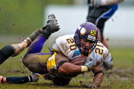 VIENNA, AUSTRIA - March 29: Austrian Football League: Running back Marcus Nolan (Vienna Vikings) scores a touchdown against the Blue Devils on March 29, 2009 in Vienna, Austria. Stock Photo - 8300594