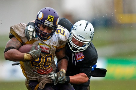 football trophy: VIENNA, AUSTRIA - March 29: Austrian Football League: Running back Marcus Nolan (Vienna Vikings) scores a touchdown against the Blue Devils on March 29, 2009 in Vienna, Austria.