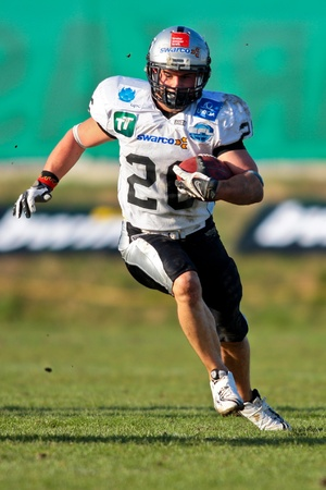 KORNEUBURG, AUSTRIA - April 4: Austrian Football League:  RB Florian Grein (#26, Raiders) scores two touchdowns against the Danube Dragons on April 4, 2009 in Korneuburg, Austria. Stock Photo - 8300561