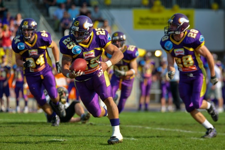 VIENNA, AUSTRIA - April 13: Austrian Football League:  RB Josiah Cravalho (#25, Vikings) scores a touchdown against the Tyrol Raiders on April 13, 2009 in Vienna, Austria.