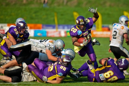 tyrol: VIENNA, AUSTRIA - April 13: Austrian Football League: RB Marcus Nolan (#20, Vikings) scores one touchdown against the Tyrol Raiders on April 13, 2009 in Vienna, Austria.