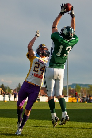 Korneuburg, AUSTRIA - April 18: Austrian Football League:  WR Thomas Haider (#13, Dragons) and his team win 57:30 against the Vienna Vikings on April 18, 2009 in Korneuburg, Austria.