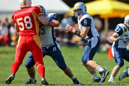 St. Poelten,  AUSTRIA - April 25: Austrian Football League - Division I:  QB Martin Ringeisen (#9, Steelsharks) and his teams lose 35:6 to the St. Poelten Invaders on April 25, 2009 in St. Poelten, Austria.
