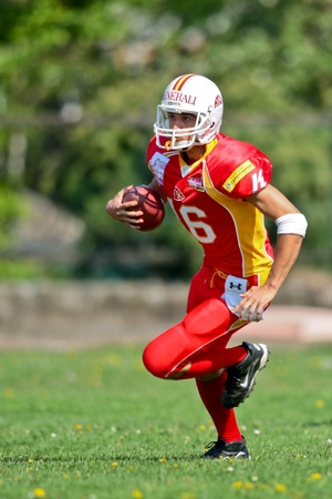 St. Poelten,  AUSTRIA - April 25: Austrian Football League - Division I:  WR Daniel Goimueller (#16, Invaders) and his team win 35:6 against the Traun Steelsharks on April 25, 2009 in St. Poelten, Austria.
