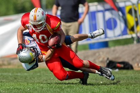 invaders: St. Poelten,  AUSTRIA - April 25: Austrian Football League - Division I: SS Hannes Baumgartner (#40, Invaders) and his team win 35:6 against the Traun Steelsharks  on April 25, 2009 in St. Poelten, Austria.