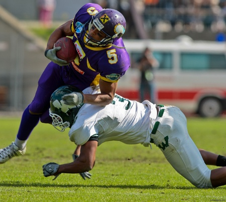 titans: Vienna,  AUSTRIA - June 1: Charity Bowl XI: WR Timothee Bach (#5, Vikings) and his team lose 14:64 to the Wesleyan Titans on June 1, 2009 in Vienna, Austria. Editorial