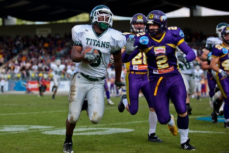 titans: Vienna,  AUSTRIA - June 1: Charity Bowl XI: DB Roman Hunter (#3, Titans) and his team win 14:64 against the Vienna Vikings on June 1, 2009 in Vienna, Austria.