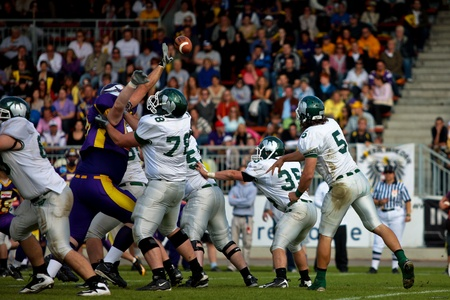 titans: Vienna,  AUSTRIA - June 1: Charity Bowl XI: QB Brien Rooney (#5, Titans) and his team win 14:64 against the Vienna Vikings on June 1, 2009 in Vienna, Austria.