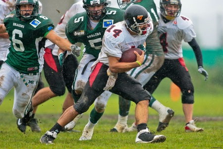 KORNEUBURG,  AUSTRIA - JUNE 20 Austrian Football League: QB DJ Hernandez (#14, Lions) and his team lose 41:35 to the Danube Dragons on June 20, 2009 in Korneuburg, Austria. Stock Photo - 8335272