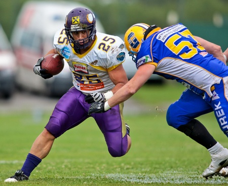 GRAZ,  AUSTRIA - JULY 18 Austrian Football League - Austrian Bowl XXV:  RB Josiah Cravalho (#25, Vikings) and his team win 22:19 against the   Graz Giants on July 18, 2009 in Graz, Austria. Stock Photo - 8448773