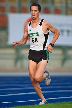 linz: LINZ, AUSTRIA - AUGUST 1 Austrian track and field championship: Michael Schmid (#68) places second in the mens 5000m race on August 1, 2009 in Linz, Austria.
