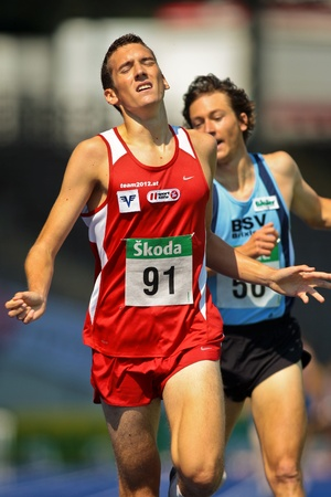 linz: LINZ, AUSTRIA - AUGUST 2 Austrian track and field championship: Andreas Vojta (#91) wins the mens 1500m race on August 2, 2009 in Linz, Austria. Editorial