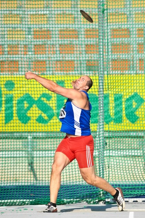 linz: LINZ, AUSTRIA - AUGUST 1 Austrian track and field championship: Gerhard Zillner (#307) places eight in the mens discus throw event on August 1, 2009 in Linz, Austria.
