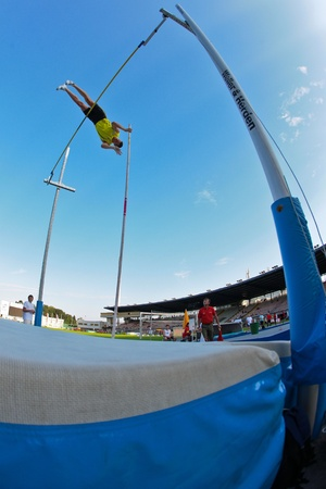 LINZ, AUSTRIA - AUGUST 1 Austrian track and field championship: Roland Schwarzl (#389) wins the mens pole vault event on August 1, 2009 in Linz, Austria.