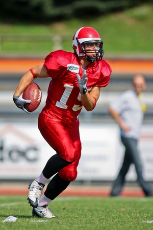 WOLFSBERG, AUSTRIA - AUGUST 20 American Football B-EC: WR Martin Vester (#15, Denmark) and his team beat the Czech Republic 34:0 on August 20, 2009 in Wolfsberg, Austria. Stock Photo - 8461505
