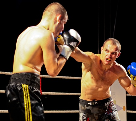 combative sport: VIENNA, AUSTRIA - OCTOBER 3 Charity Boxing:  Sladi Apanovic (left, Austria) beats Michael Paris (right, Slovakia) in a cruiser weight fight on October 3, 2009 in Vienna,  Austria.