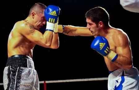 VIENNA, AUSTRIA - OCTOBER 3 Charity Boxing:  Gogi Knezevic (left, Austria) beats Joseph Sovijus (right, Slovakia) in a middleweight fight on October 3, 2009 in Vienna,  Austria.