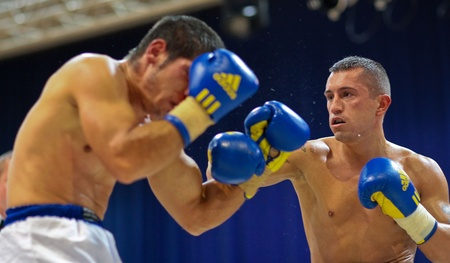 VIENNA, AUSTRIA - OCTOBER 3 Charity Boxing:  Gogi Knezevic (right, Austria) beats Joseph Sovijus (left, Slovakia) in a middleweight fight on October 3, 2009 in Vienna,  Austria.