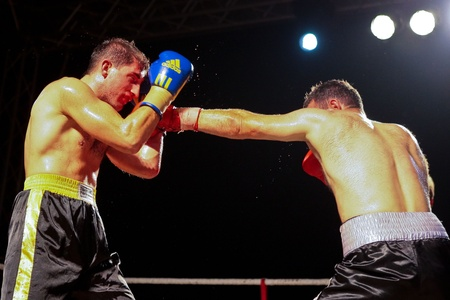 combative sport: VIENNA, AUSTRIA - OCTOBER 3 Charity Boxing:  Chussein Dombaev (right, Austria) beats Michael Tomko (left, Slovakia) in a  super middelweight fight on October 3, 2009 in Vienna,  Austria. Editorial