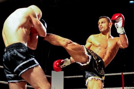 VIENNA, AUSTRIA - OCTOBER 3 Charity Boxing:  Sasa Jovanovic (right, Austria) beats Laszlo Simon (left, Hungary) in a K1 fight on October 3, 2009 in Vienna,  Austria.
