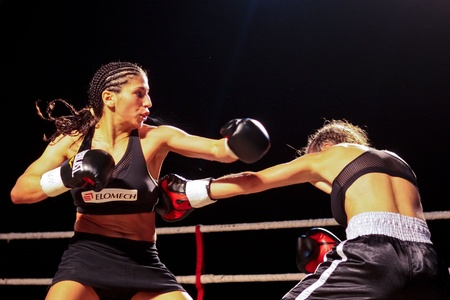 combative sport: VIENNA, AUSTRIA - OCTOBER 3 Charity Boxing:  Nadia Raoui (left, Germany) beats Fleis Djendji (right, Serbia) in a fly weight fight on October 3, 2009 in Vienna,  Austria.