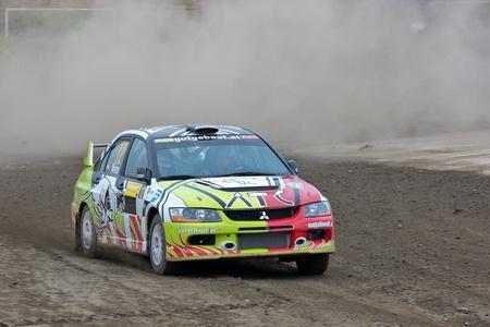 mud slide: HORN, AUSTRIA - OCTOBER 31: Raimund Baumschlager wins the 28th Waldviertel Rallye on October 31, 2009 in Horn, Austria. Shown is austrian driver Reinhard Pasteiner who finished ninth.