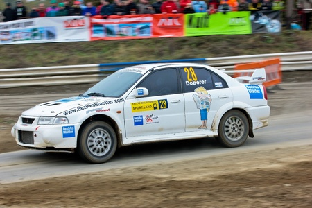 mud slide: HORN, AUSTRIA - OCTOBER 31: Raimund Baumschlager wins the 28th Waldviertel Rallye on October 31, 2009 in Horn, Austria. Shown is austrian driver Wolfram Doberer.