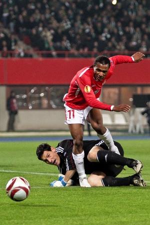 payer: VIENNA,  AUSTRIA - NOVEMBER 5 SK Rapid loses 0:3 to Hapoel Tel Aviv on November 5, 2009 in Vienna, Austria. Shown are goalkeeper Helge Payer (Rapid, #24) and striker Samuel Yeboah (Hapoel, #11).