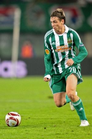 VIENNA,  AUSTRIA - NOVEMBER 5 SK Rapid loses 0:3 to Hapoel Tel Aviv on November 5, 2009 in Vienna, Austria. Shown is striker Rene Gartler (Rapid, #20). Stock Photo - 8465376