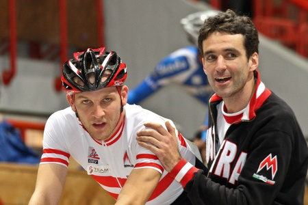 keirin: VIENNA,  AUSTRIA - JANUARY 11 Indoor track cycling meeting - Andreas Mueller (Austria, left) places ninth in mens point race final on January 11, 2010 in Vienna, Austria.