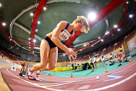 VIENNA,  AUSTRIA - FEBRUARY 2 Indoor track and field meeting. Viola Kleiser (Austria) places 2nd in the women's 200m sprint on February 2, 2010 in Vienna, Austria. Stock Photo - 8465426