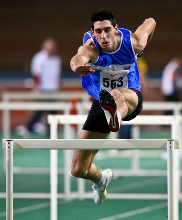 VIENNA,  AUSTRIA - FEBRUARY 16  Vienna indoor  track and field meeting. Sanjin Simic (Croatia) places  10th in the men's 60m hurdles event on February 16, 2010 in Vienna, Austria. Stock Photo - 8465284
